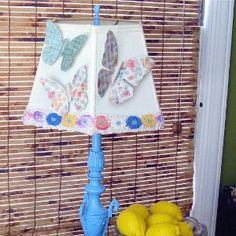 The Fluttering Butterfly Lampshade Redo is a fabulous home decor paper craft for a little girl's bedroom.