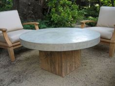 Round concrete-top coffee table... inspiration for sunroom DIY craft table, but on casters.