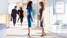 Gina Torres as Jessica Pearson and Sarah Rafferty as Donna Paulsen in Suits