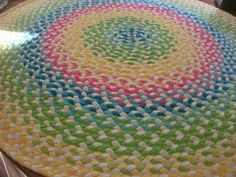 Neon braided rug created from about 50 recycled t shirts. All of the colors are married with pure white t shirt fabric...beautiful!