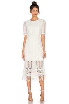 Fall for fringe + rock a linear lace dress with a fringed hem for a boho-meets-on-trend rehearsal dress.