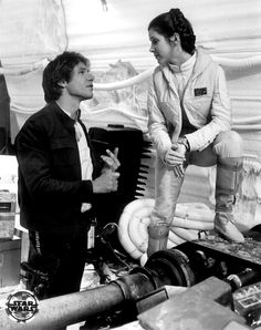 Harrison Ford as Han Solo and Carrie Fisher as Princess Leia in a behind the scenes photo from Star Wars The Empire Strikes Back