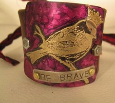 etched metal bird cuff be brave womans bracelet recycled. $31.00, via Etsy.
