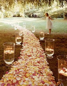 Bold petal #wedding aisle with large hurricane lamps