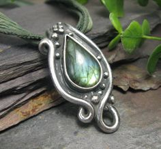 Bezel set Labradorite gem in a setting made from extruded clay.