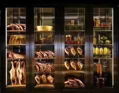A wall-sized fridge packed with hanging ducks and aging lamb separates the dish station from the dining room. Restaurant Design, Restaurant Bar, Display Shelves, Shelving, Co Op Store, Momofuku, Locker, Separates, Charleston