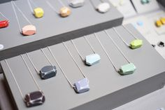 Lovely grey painted blocks complement the jewellery in this craft fair display