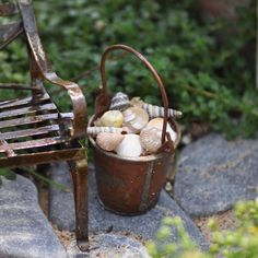 Gathering Seashells  Complement a mini metal garden bench with a matching metal bucket full of shells, mini pumpkins or plant clippings.