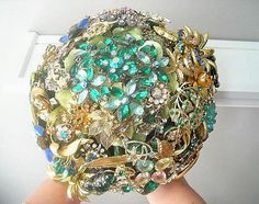 Make a bouquet, a Christmas tree or any decorative piece with vintage costume jewelry.  Love those sparklies!