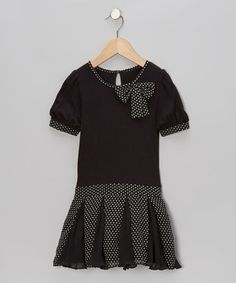 Whirling and twirling is unavoidable in this darling dress. Boasting pretty polka dots for style and all-cotton construction for comfort, this girly getup is a perfect partner from play to party.