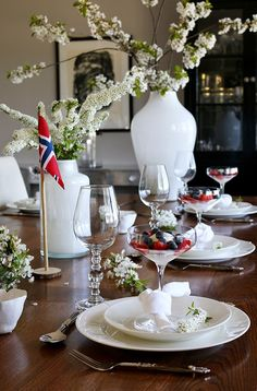 Happy Birthday to Norway! We are celebrating 17th of May, our Constitution Day. This year I decorated two different tablesetting ideas for my guests and blog followers. This year I used Spiraea cinera (Grefsheim) and branches of cherry for the table, for me the ultimate sign of spring in Norway. Clean white white crockery and napkins stands out to the dark oak table. Fore more pictures, please visit my interior blog: http://anettewillemine.com/