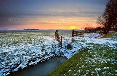 sunset over dutch farmland ...  blue, canal, countryside, dramatic, dusk, dutch, evening, farm, farmland, fence, field, frozen, grass, green, holland, horizon, ice, landscape, meadow, nature, netherlands, no people, nobody, orange, outdoors, outside, pasture, plain, red, river, rural, scenery, scenic, season, seasonal, sky, snow, sun down, sundown, sunlight, sunny, sunset, tree, view, winter