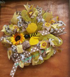 Check out this item in my Etsy shop https://www.etsy.com/listing/448652018/bumble-bee-wreath-summer-deco-mesh