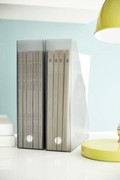 Our Like-it® Magazine Files accommodate magazines, files or papers stored vertically (shown) or horizontally. Both the base and the spine have a round cut-out making it easy to pull the file from the shelf. The open sides allow for storage of taller, longer items.