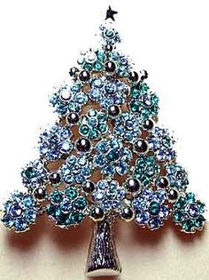 Kirk's Folly Flora Danica Christmas Tree Pin in silvertone with teal and light sapphire rhinestones