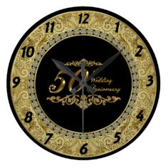 """A Digitalbcon Images Design featuring a gold and black color theme with a variety of custom images, shapes, patterns, styles and fonts in this one-of-a-kind """"Golden Wedding Anniversary"""" Clock. This elegant and attractive design makes the ideal gift for the Anniversary Couple on the special occasion and comes with a Glittering Gold and Diamond Anniversary Greeting."""