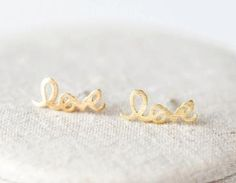 LOVE Earrings, Gold LOVE Studs, Friendship Posts, Letter Stud EarringsSo simple and modern Everyday Jewelry!♥ Infinity size: W 80 mm X H 16 mm♥ Post: 925 sterling silver Post♥ Color Option: Silv..