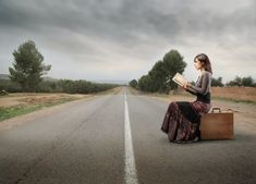 Photo about Woman sitting on a suitcase on a countryside road and reading a book. Image of travel, fashion, road - 17610849 Glamour Shots, Destin Beach, France, Girls Image, Birds In Flight, Beautiful Images, Countryside, Books To Read, Country Roads
