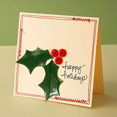 Manilla folders make a great low-cost card base. Decorate your cutout cards with cardstock holly leaves and red buttons for a bit of cheer. Tip: Get shiny leaves by covering green cardstock with dimensional adhesive and letting it dry before cutting the leaves and folding them lengthwise.