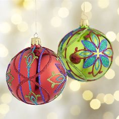 Richly colored glitter sparkles in folk art floral patterns on shiny red or green ball ornaments. Each ornament represents the exceptional skills of master glassblowers and designers, who use traditional Old World techniques at a workshop that has specialized in crafting ornaments since 1949.