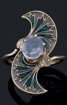 An Art Nouveau sapphire, plique-à-jour enamel and gold ring, circa 1900. #GoldJewelleryArtNouveau