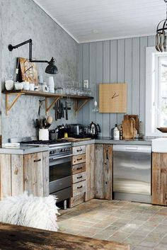 Cute rustic kitchen in neutral hues and distressed wood