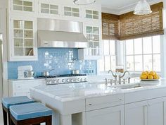I love the idea of a bright color for the backsplash and in a subway tile.  Really like the cabinets, too.