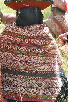 """David VanBuskirk, photographer. An Inca weaver at Accha Alta, Peru wearing her handwoven manta. The patterns have meanings with complex associations that usually represent elements of the natural world and the land, Pacha Mama. Inspiration for my book """"Beyond the Stones of Machu Picchu: Stories and Folk Tales of Inca Life"""" by Elizabeth VanBuskirk. For more information on village weaving in Chinchero see """"Descendants of the Incas""""  incas.org"""