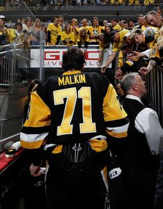 TAMPA BAY LIGHTNING VS. PITTSBURGH PENGUINS - GAME SEVEN PITTSBURGH, PA - MAY 26: Evgeni Malkin #71 of the Pittsburgh Penguins walks down the runway after a 2-1 win over the Tampa Bay Lightning in Game Seven of the Eastern Conference Final during the 2016 NHL Stanley Cup Playoffs at Consol Energy Center on May 26, 2016 in Pittsburgh, Pennsylvania. (Photo by Gregory Shamus/NHLI via Getty Images)