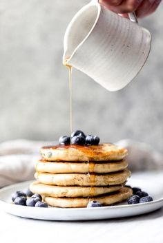 Fluffy almond flour pancakes with only 5 ingredients: almond flour, baking soda, coconut milk, eggs and vanilla extract. A great keto and low carb pancake recipe. Options to add blueberries or chocolate chips!