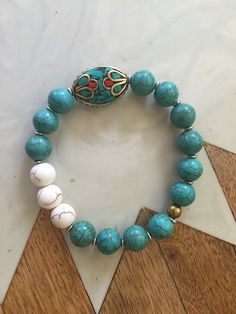 Turquoise and white howlite beaded bracelet with Tibetan bead detail. Wear alone as a unique statement or stacked for a bold bohemian look. All bracelets are made at a standard size on flexible string, for a custom size please include a taut wrist size with your order. Go your own way. xx. La Vie Boheme
