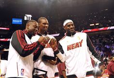 Oct 30, 2012; Miami, FL, USA; Miami Heat shooting guard Dwyane Wade (left) – power forward Chris Bosh (center) – small forward LeBron James (right) after receiving their NBA championship rings before a game against the Boston Celtics at American Airlines Arena. Mandatory Credit: Steve Mitchell-US PRESSWIRE