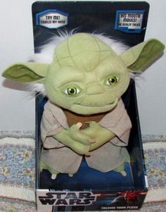 "Star Wars Talking Yoda Plush  This 12"" talking re-creation of absolutely everyone's favorite Jedi Master says some of his unforgettable sayings when his tummy is pressed, ""For 800 years have I trained Jedi"", ""Do, or do not. There is no try."", ""Judge me by my size do you. Size matters not""."