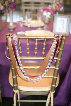 gold & purple ribbons with a string of crystal beads... or even ivory pearls... nice!
