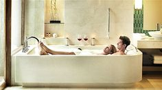 Take a bubble bath  What's the point of having a big bathtub if you're not going to use it? Light some candles, turn on soft music and take a dip in your own bathroom. Not only will a bath relax you and your hubby, it's also an excellent time to catch up on intimate conversation in your otherwise busy lives. As the weather warms up, a mild bath is also the perfect way to soothe summer skin problems, such as sun rash, bug bites and dry skin.