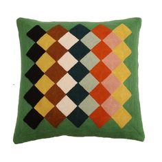 A hand-embroidered cushion with tightly chain stitched New Zealand wool yarn designd by Gabrielle Soyer of LINDELL & CO. Each cushion is entirely hand made, the weaving and knotting are completed by skilled artisans in India.