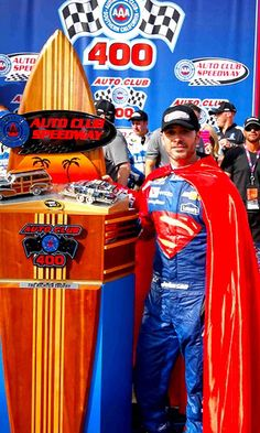 ➟ Jimmie Johnson, driver of the #48 Lowe's / Superman Chevrolet, celebrates after winning the NASCAR Sprint Cup Series Auto Club 400 at Auto Club Speedway on March 20, 2016 in Fontana, California.