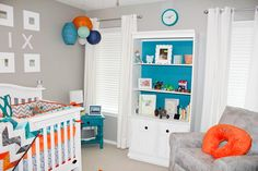Love the blue pop of color in this nursery bookshelf! #nursery