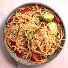 This bright and colorful Asian Noodle Salad is a gluten-free vegan meal that's filled with fresh vegetables and tossed in a spicy creamy nutty dressing | Asian Salad | Noodle Recipes | Healthy Noodles | #recipevideo #videorecipes #noodles #asianfood #healthyrecipes #salad #feelgoodfoodie via @feelgoodfoodie1