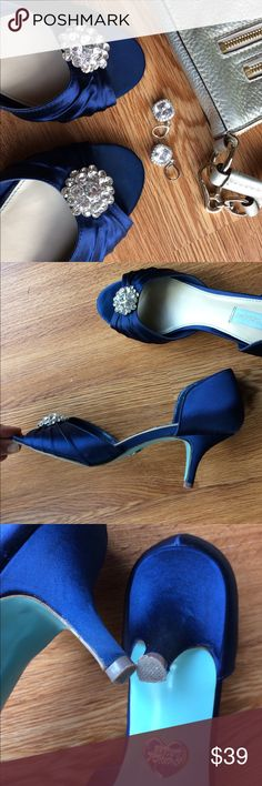"""Betsey Johnson heels embellished satin blue Betsey Johnson 2 1/4"""" inch heels. Midnight blue satin. Open to gathered to unite at flowered gems. At the tip of my finger is a partial scuff that did not break through the fabric. Size 8 / 8.5 Betsey Johnson Shoes Heels"""