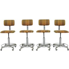 Set of Four Adjustable Mid Century Industrial Stools/Chairs on Casters (not in love with the fabric)
