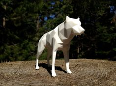 Low poly wolf designed in Whistler, Canada. 3D printed in the US by Shapeways