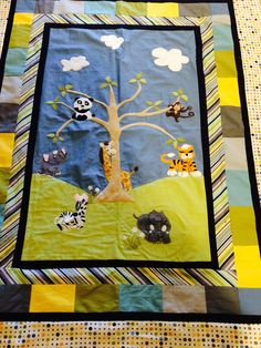 Zoo Animal Baby Quilt. Hand designed, machine quilted