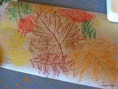 Leaf Rubbings.  you could have the kids make place mats for Thanksgiving lunch/dinner.  they would love to have there art work on display!
