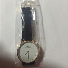 Daniel Wellington watch Brand new Inspired Daniel Wellington watch . Classy Sheffield style . 40 mm diameter , water resistant . Gold face and black strap .Please no Trades , dont lowball me . I have a perfect rating , trusted seller and fast shipper . Very beautiful and for a great price :D happy customers happy seller Daniel Wellington Accessories Watches