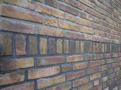 trasraam in zelfde steen andere kleur voeg t/m halfsteens rollaag rollaag vlak met overig metselwerk