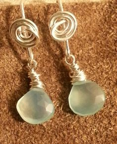 "Spring continues to bloom at Creations By Hellena. This latest collection is called ""A Day at the Beach"". See them up close and personal at Mindfulnest Santa Monica in the coming weeks. Pale green Chalcedony wrapped in Sterling Silver. #jewelry #accessories #earrings #silver"