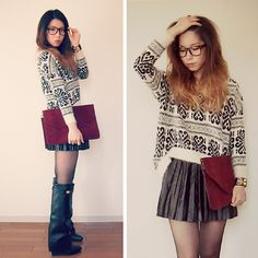 Black skirt, white & black printed sweater, maroon large envelope clutch, tights, leather boots