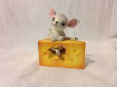 Vintage Mouse and Cheese Salt and Pepper Shakers. Made in Japan. Missing 1 Stopper. Approx. Dimensions (displayed): 3in x 2in x 4in. Crazing/Paint wear due to age.
