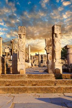 The Heracles Gate at the begining of Curetes Street , showing Heracles wrapped in a Nemea Lion skin. Probably made in the 2nc century A.D. and moved to Ephesus in the 5th century A.D. Ephesus Archaeological Site, Anatolia, Turkey. | Photos Gallery